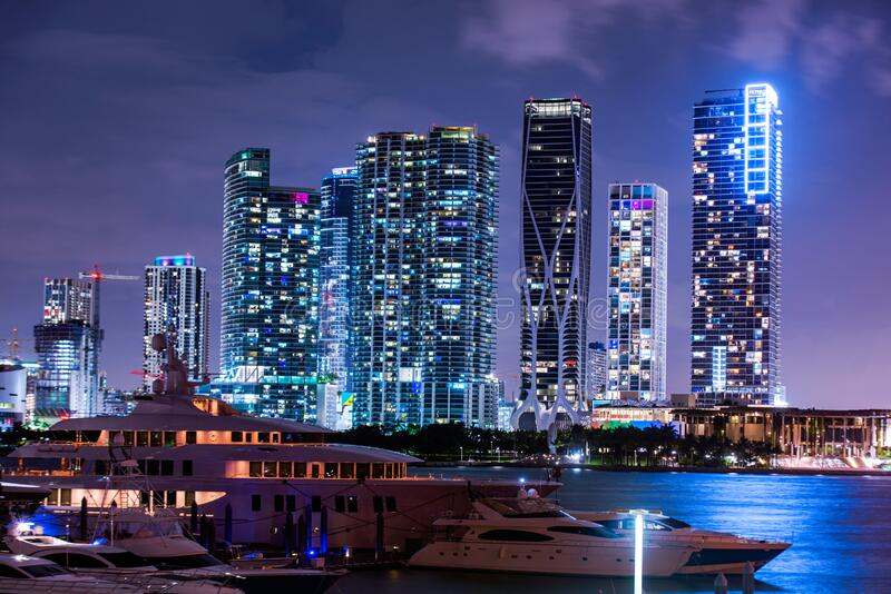Miami south beach street view with water reflections at night. Miami downtown. royalty free stock photo