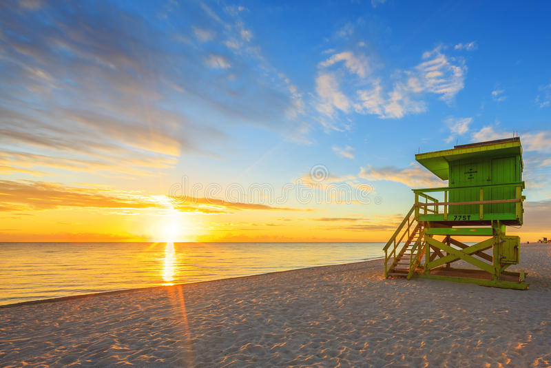 Miami South Beach sunrise and lifeguard tower. Miami South Beach sunrise with lifeguard tower royalty free stock photography