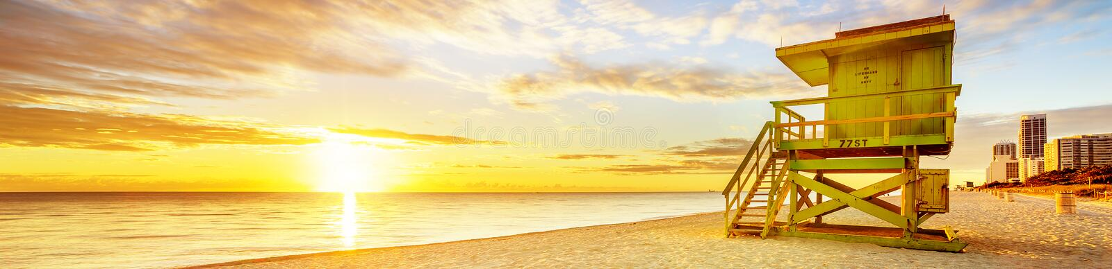 Miami South Beach sunrise. With lifeguard tower and coastline with colorful cloud and blue sky royalty free stock photography