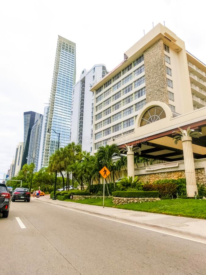 Miami, United States of America - November 30, 2019: Street with famous hotels at Collins Avenue in Miami. Beach stock photography