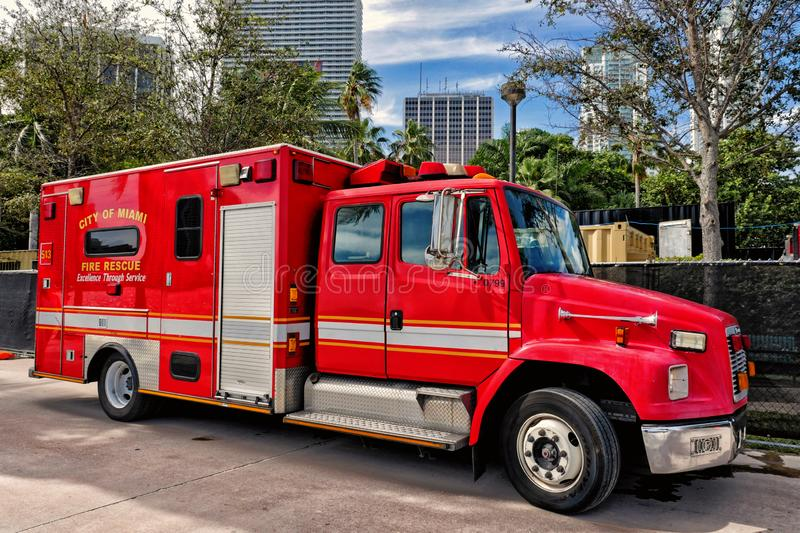 Red fire fighter rescue car. Miami, Usa- January 5, 2015: Red fire fighter rescue car truck on the street of Miami, Florida royalty free stock image
