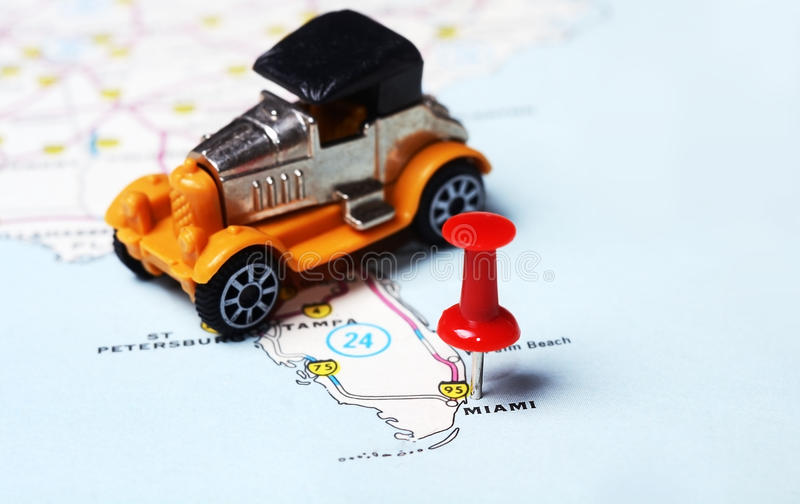 Miami USA map retro car. Close up of Miami USA map with red pin and retro car toy - Travel concept stock image