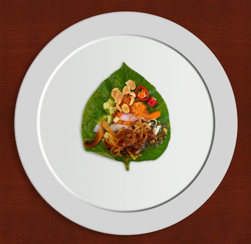 Miang Kham, det thailändska savoury tugga-formatet blad-slogg in aptitretaren arkivfoton