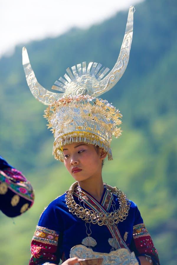 Miao Ethnic Minority Traditional Costume Headdress. Xijiang, China - September 15, 2007: An ethnic minority Miao woman in traditional festival costume and large royalty free stock photos