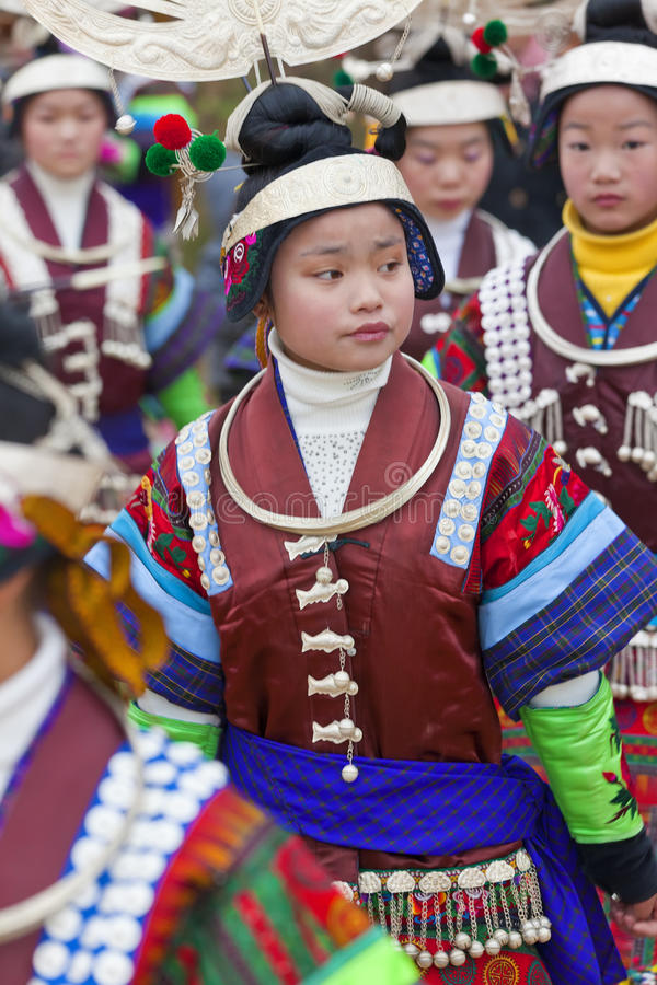 Miao girls dancing at festival nr Kaili, Guizhou Province, royalty free stock photo