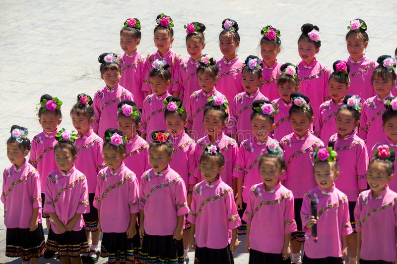 Miao Minority Adolescent Girls Pink Costume Sing. Xijiang, China - September 15, 2007: Cute adolescent Miao ethnic minority girls singing in pink festival stock images