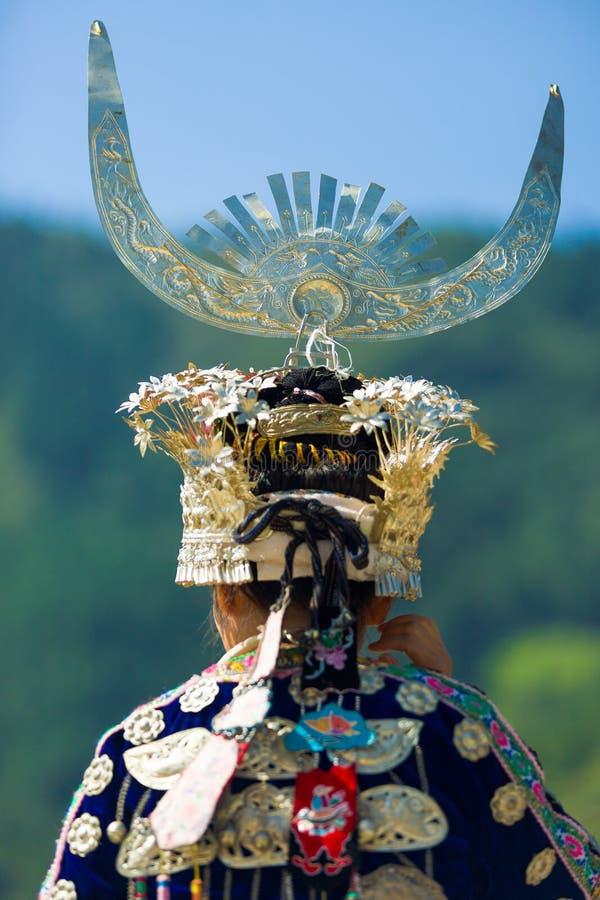 Miao Minority Woman Traditional Headdress Rear. Xijiang, China - September 15, 2007: Rear view of ethnic minority Miao woman in traditional festival clothes and royalty free stock image