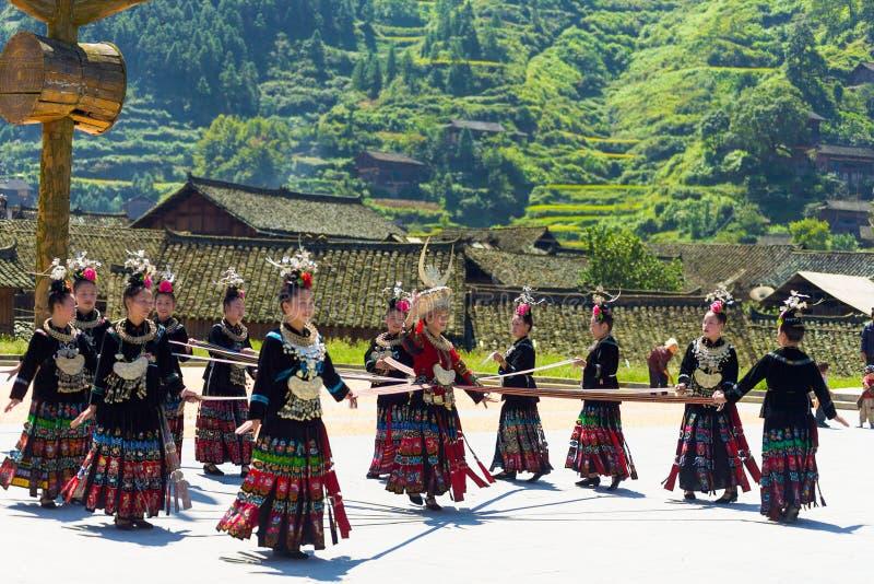 Miao Minority Women Ribbon Dance Festival Xijiang. Xijiang, China - September 15, 2007: Miao women use a ribbon and dance wearing full traditional festival stock image