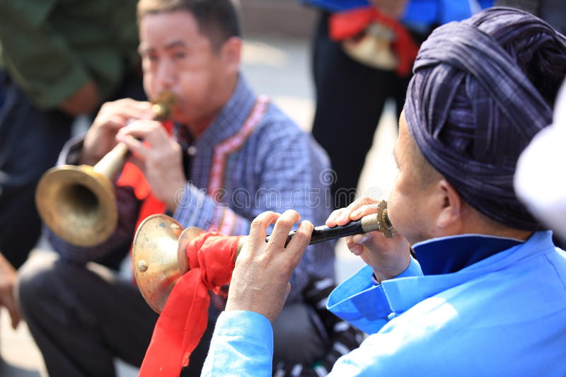 Miao nationality men playing music instrument. To celebrate the local festival at fenghuang ancient town,china oct,13,2013 royalty free stock photos