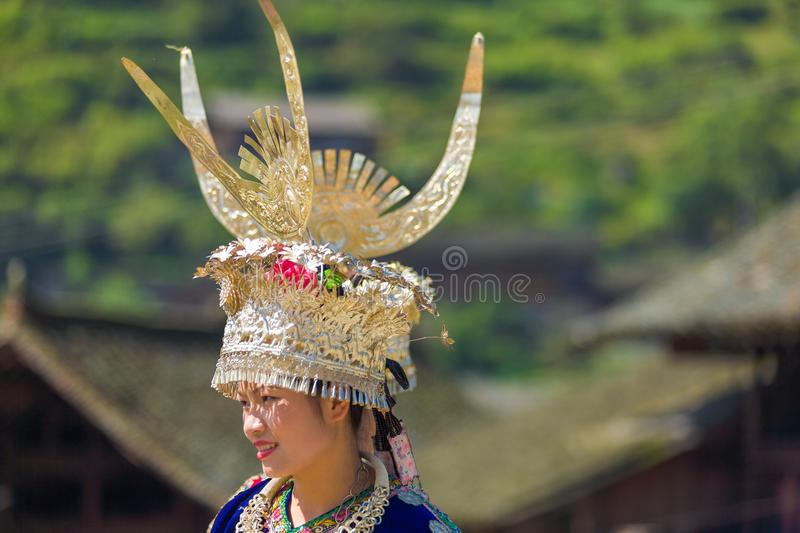 Miao Woman Traditional Horn Headdress Garb Village. Xijiang, China - September 15, 2007: Front portrait of Miao woman in traditional silver horn headdress and royalty free stock image