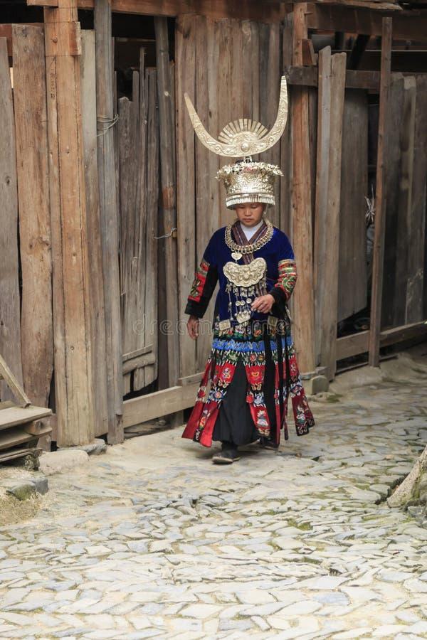 Miao woman wearing the traditional Miao attire in Langde Miao village, Guizhou province, China. Langde, China - March 27, 2018: Miao woman wearing the royalty free stock photos