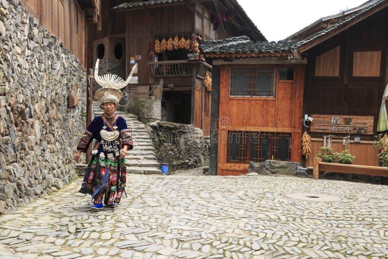 Miao woman wearing the traditional Miao attire in Langde Miao village, Guizhou province, China. Langde, China - March 27, 2018: Miao woman wearing the stock photo