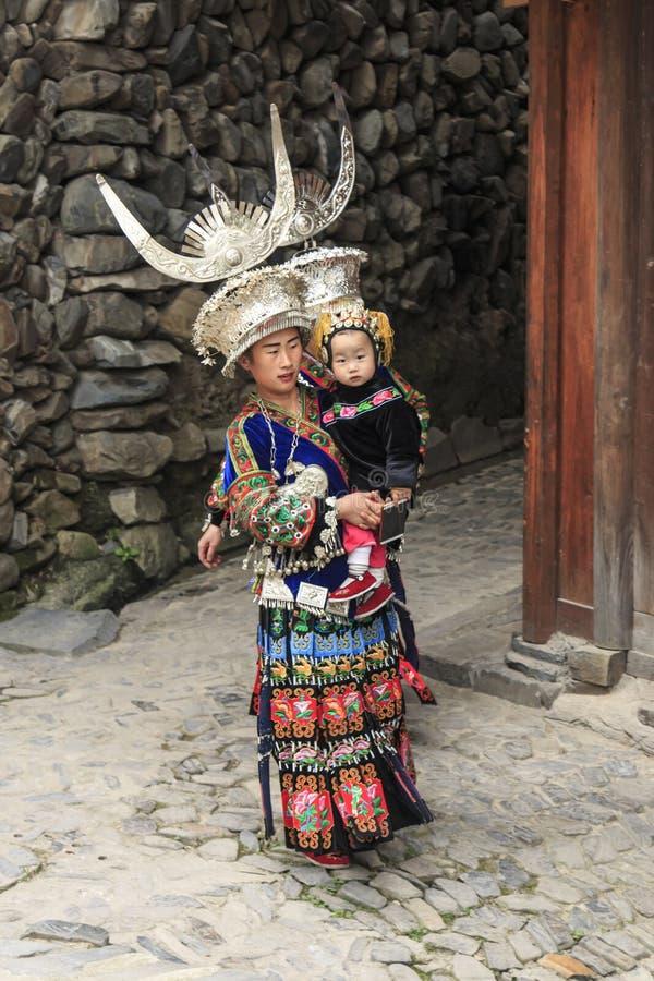Miao woman wearing the traditional Miao attire in Langde Miao village, Guizhou province, China. Langde, China - March 27, 2018: Miao woman wearing the royalty free stock photography