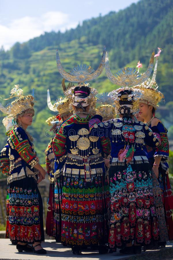 Miao Women Group Traditional Festival Costume. Xijiang, China - September 15, 2007: Group of Miao women wearing full traditional festival regalia, colorful royalty free stock photo