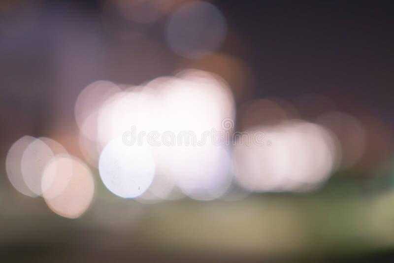 Miasta światła krajobrazu tło Kolorowi okręgi jarzy się światła Bokeh zdjęcia stock