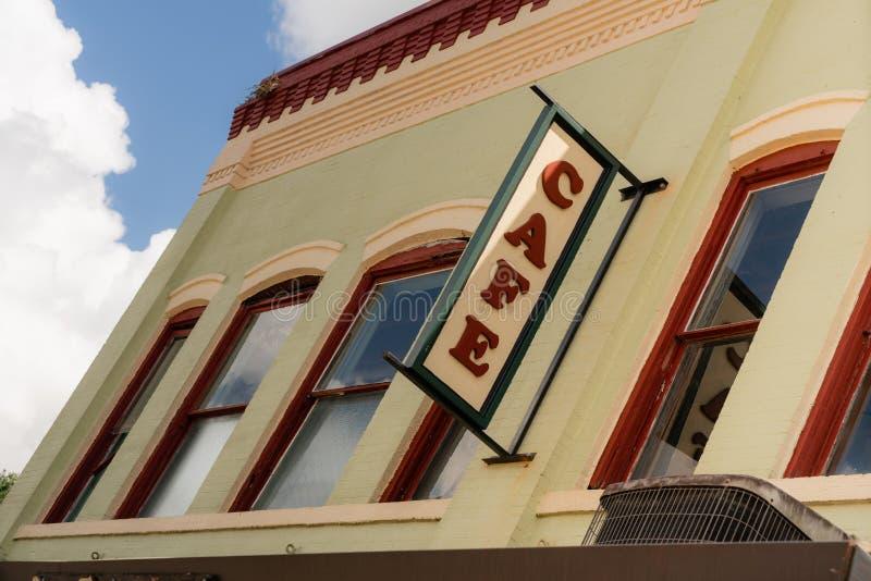 Miasteczko kawiarni znaka Lokalna Miastowa Restauracyjna knajpa zdjęcie royalty free