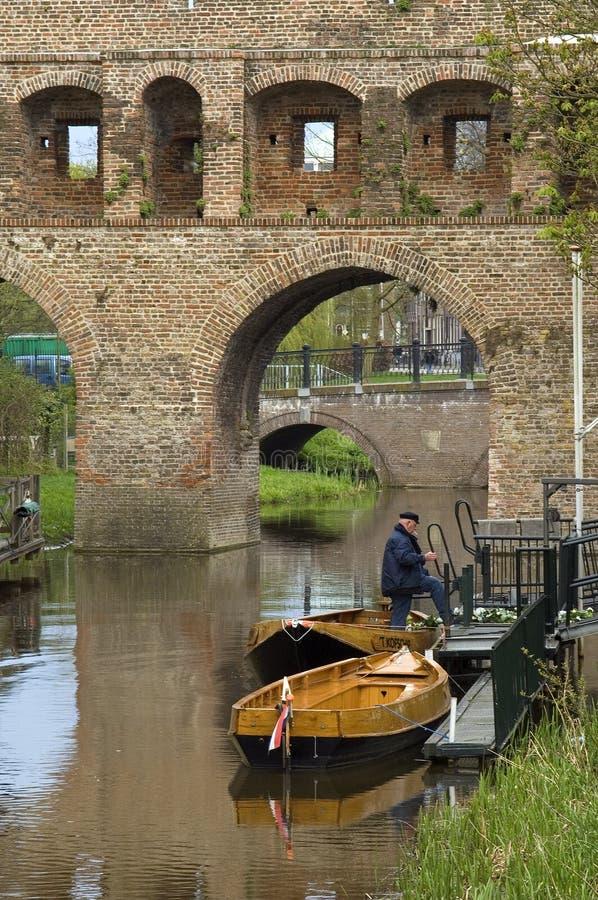 Miasto brama Berkelpoort, rzeczny Berkel i łodzie, zdjęcia stock
