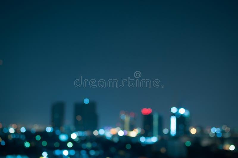 Miasto noc zaświeca abstrakcjonistycznego tło fotografia royalty free