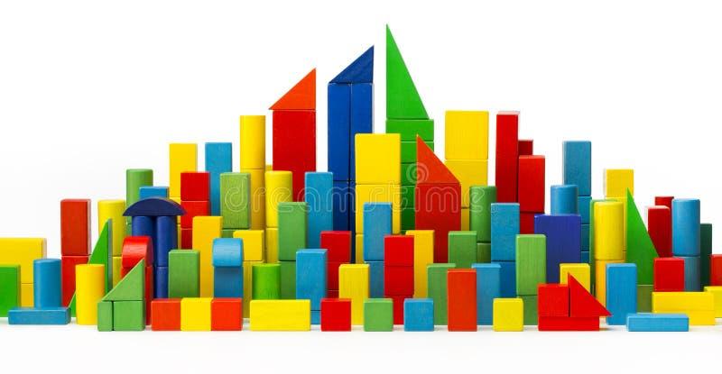 Miasto zabawki bloki, Basztowi budynku koloru domy, Drewniany miasteczko, Biały obrazy royalty free