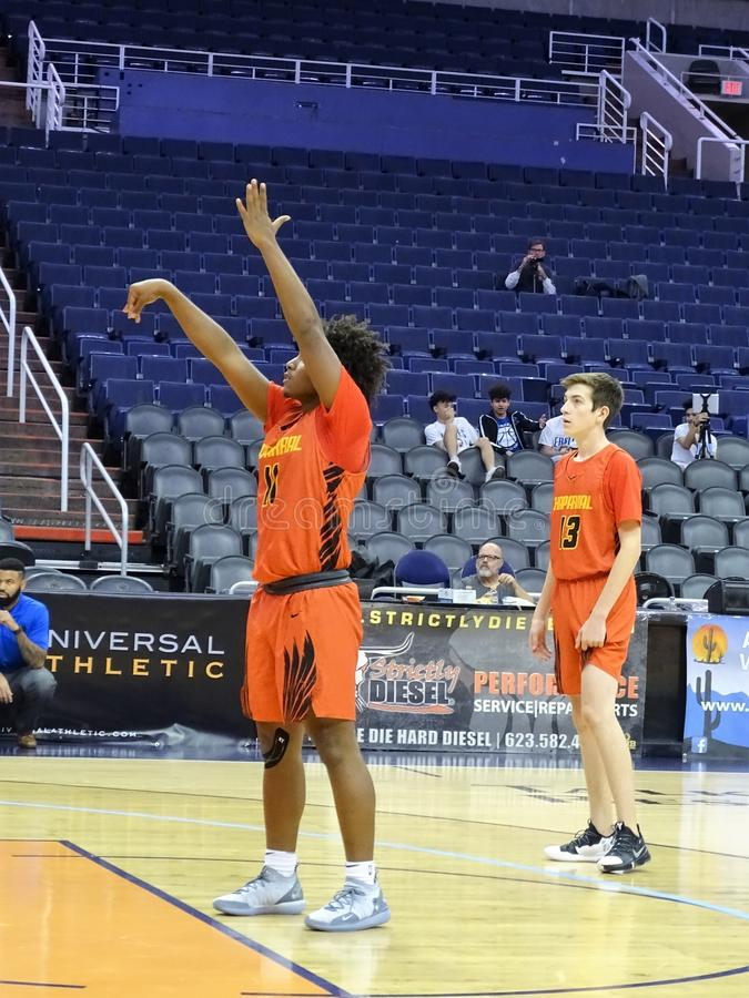 2018 Hoopin` It Up at the Arena at Talking Stick Resort Arena. Micah Burno and Matthew Whisler from Chaparral at Chaparral Firebirds vs. Sandra Day O`Connor royalty free stock image
