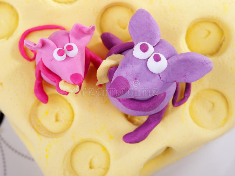 Mice on cheese fondant cake. Shot from above royalty free stock photos