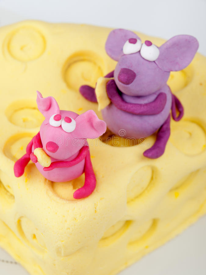 Mice on cheese fondant cake. Shot from above stock image