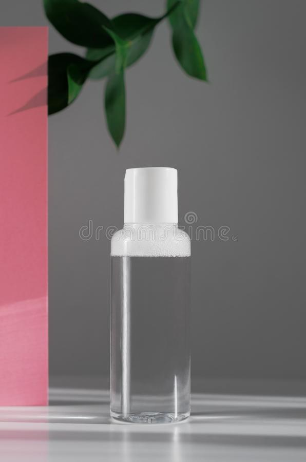 Micellar water, moisturizing lotion mock up side view. Natural cosmetology, organic cosmetics creative botanical concept. Plastic. Bottle with transparent stock photo