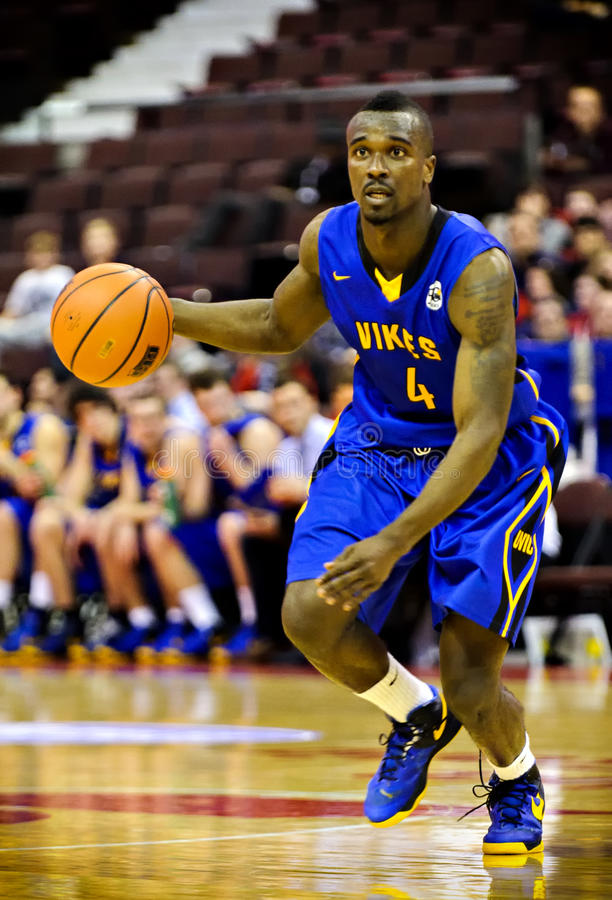 Men's CIS Basketball Finals. Michael Acheampong in action for the Victoria Vikes in their match against the Carleton Ravens at Scotiabank Place, Ottawa on March royalty free stock photography
