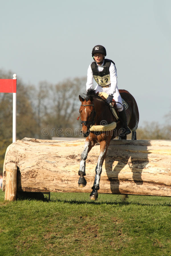 Michael Jung. Double Olympic Gold Medallist Michael Jung (GER) and La Biosthetique Sam FBW jumping the Horsequest Quarry fence while competing in the cross royalty free stock photo