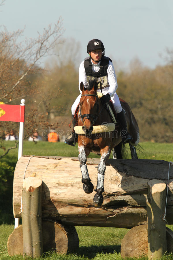 Michael Jung and Sam. Double Olympic Gold Medallist Michael Jung (GER) and La Biosthetique Sam FBW jumping the second element of the Horsequest Quarry fence at stock photos
