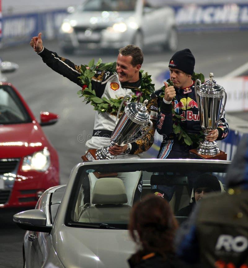 Michael Schumacher en Sebastian Vettel stock foto's