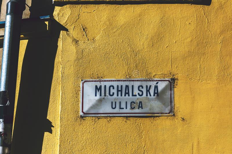 Michalska ulica, main street sign in Bratislava old town, on the. Yellow wall, Slovakia stock photos