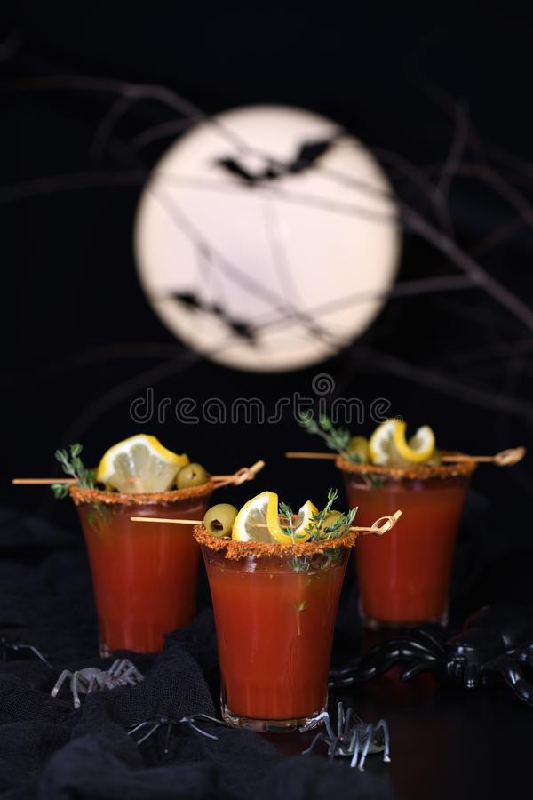 Cocktail  Bloody Mary for a Halloween party. Michelada - Mexican alcoholic cocktail, tomato juice, spicy sauce and spices. Great idea for a Halloween party royalty free stock photography