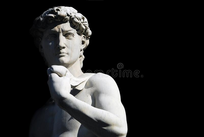 Michelangelo`s David. Statue on black background, with place for your design or text stock images