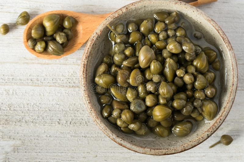 Capers. A bowl of capers stock photo