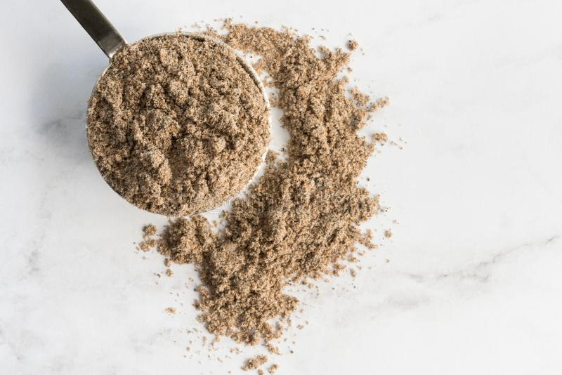 Ground Cardamom Spilled from a Teaspoon royalty free stock images