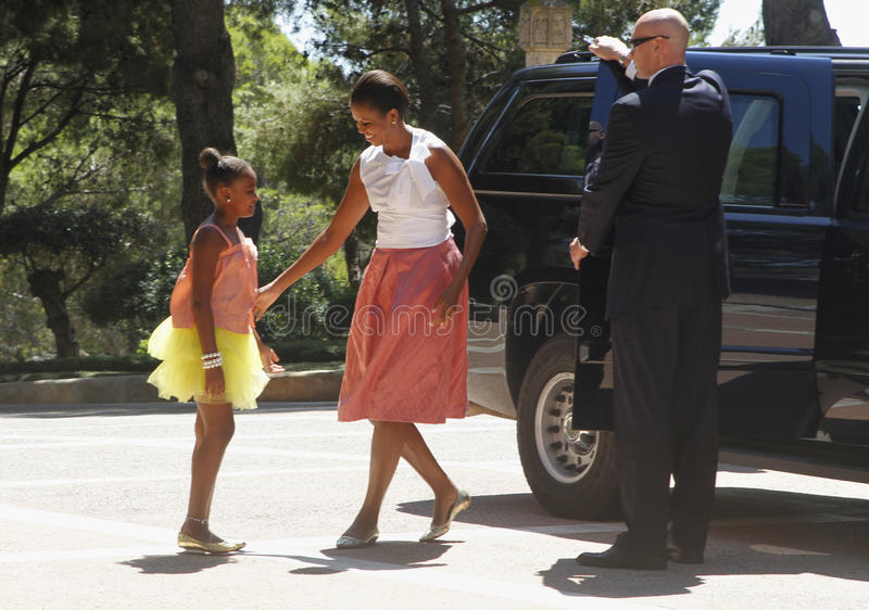 Michelle Obama and her daughter Sasha arriving at marivent palace royalty free stock photos