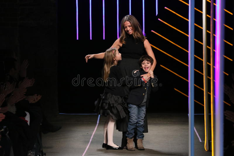 Michelle Smith bows with her children at the Milly By Michelle Smith Show during MBFW Fall. NEW YORK, NY - FEBRUARY 16: Michelle Smith bows with her children at stock photos