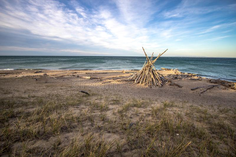 Michigan Lake Superior Beach Background. Wild and scenic shore of Lake Superior with rustic beach hut. Whitefish Point, Upper Peninsula, Michigan, USA royalty free stock images