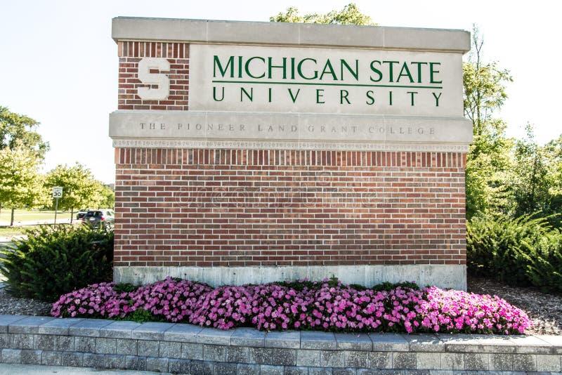 Michigan State University Emblem och loggar in i East Lansing arkivbilder