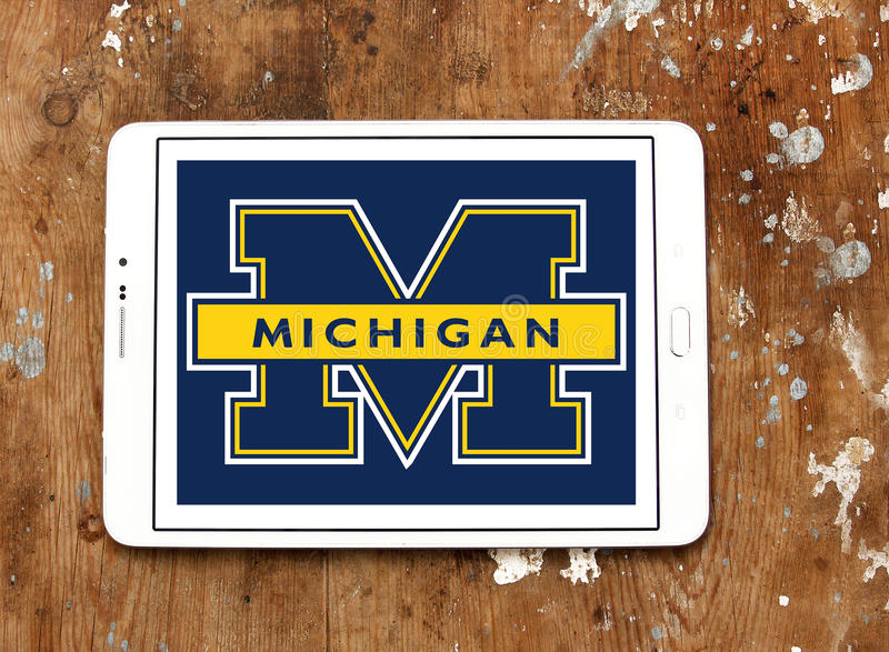Michigan Wolverines american football team logo. Logo of Michigan Wolverines american football team on samsung tablet on wooden background. The Michigan stock photos