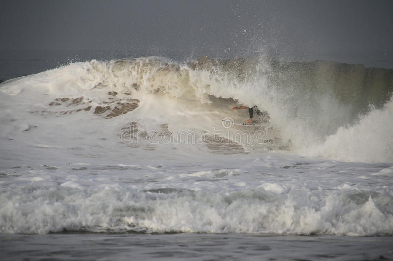 Download Fanning tube riding a wave editorial photography. Image of foam - 34816907