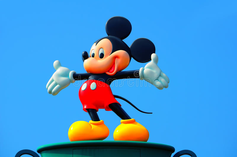 Mickey mouse. Statue of mickey mouse against natural blue sky background at disneyland, hong kong