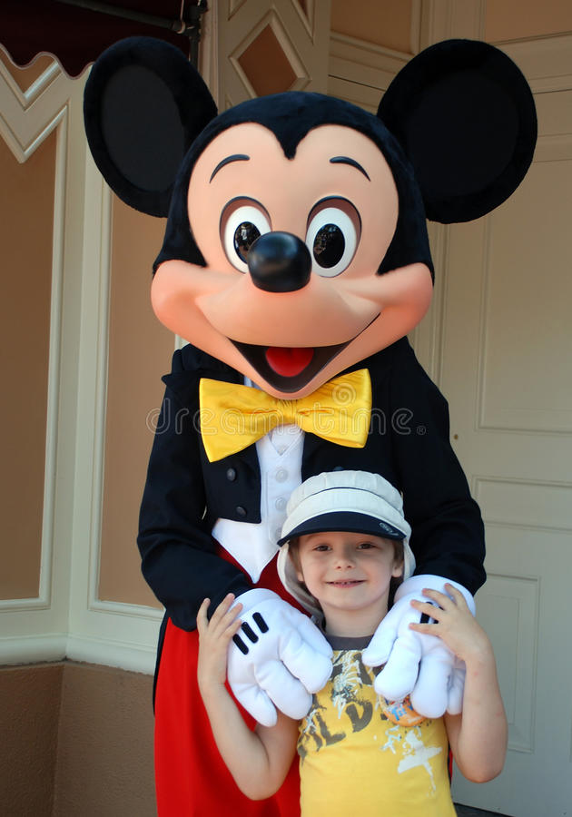 Free Mickey Mouse And Boy In Disneyland Stock Image - 16518861
