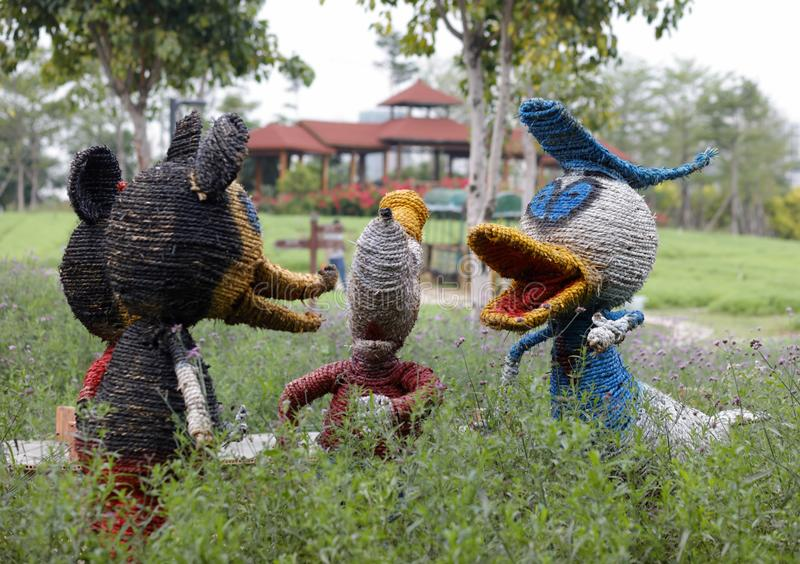 Mickey Mouse and Donald Duck sculpture made with straw, adobe rgb stock image