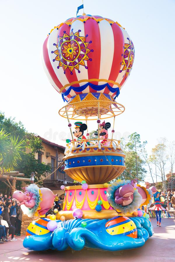 Mickey Mouse and Minnie Mouse riding in a float royalty free stock photo