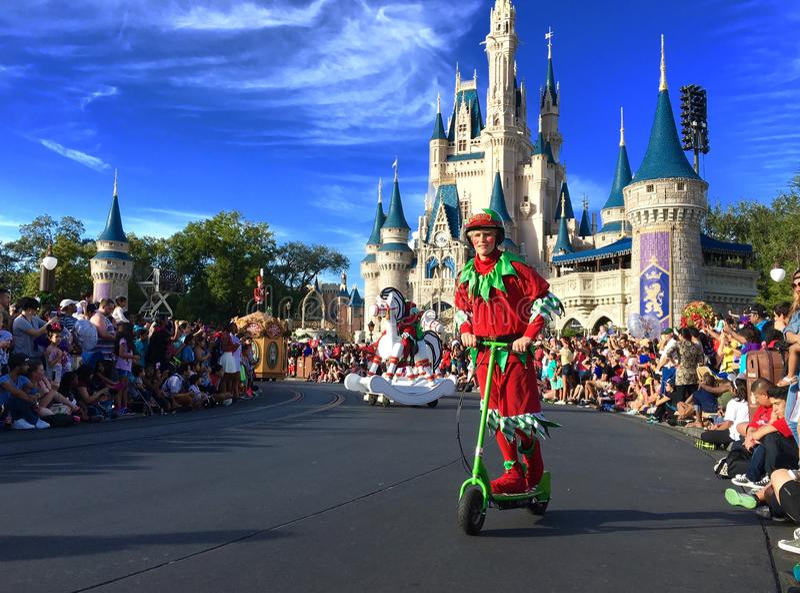 Mickey's Very Merry Christmas parade party at Disney World. Elf riding scooter at Christmas holiday parade party Walt Disney World Magic Kingdom,Orlando,Florida stock photography