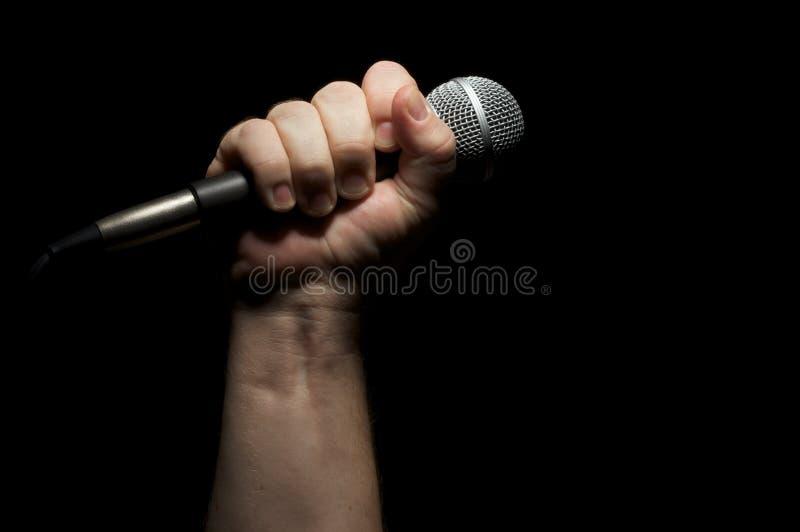 Micrófono en el puño imagen de archivo