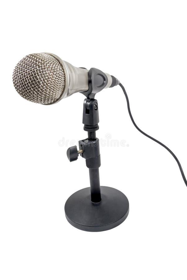 Micrófono en un fondo blanco fotografía de archivo