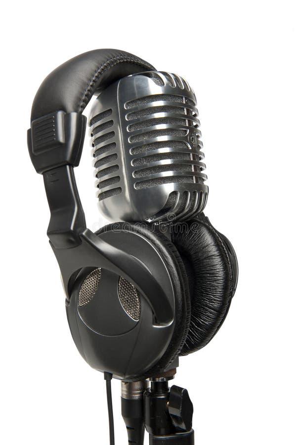 Micrófono y auriculares de la vendimia imagenes de archivo